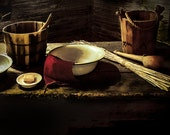 Table photograph log cabin interior country school, wooden buckets, tin plates, dark atmosphere, simple farmhouse, good ole days nostalgic