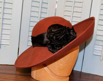 Beautiful Brown hat with black satin rose