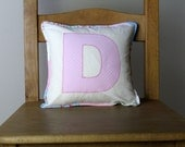 Letter cushion in pink