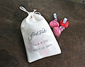 """Personalized wedding favor bags, 3x4.5. Set of 50 double drawstring muslin bags.  Italian """"Grazie"""" in black on natural white cotton."""