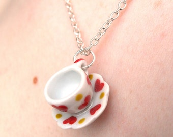 Mini ceramic tea cup necklace with red heart pattern