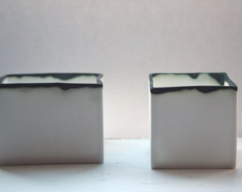 Pure white cube set made from fine bone china and burnt effect rims - geometric decor