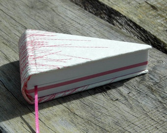 piece of pie book in off-white with pink stitches