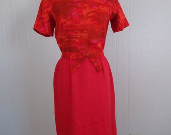 1960's Red Wiggle Dress Stephan Ltd. Bright red with bow accent at the waist.