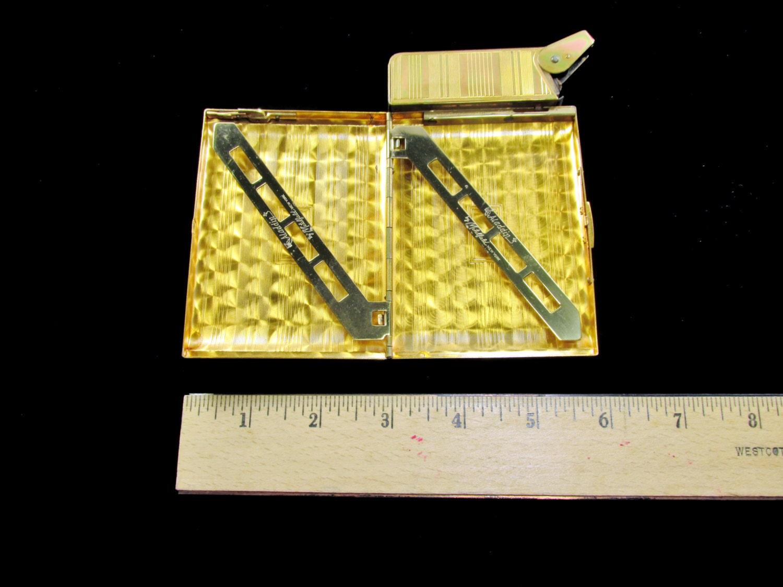vintage cigarette case with lighter gold tone signed aladdin