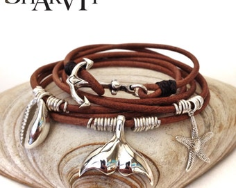 Sterling silver cowrie (sea shell), sea star, whale tail and anchor leather bracelet