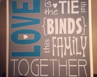 Love is the tie that binds this family together- Wood Canvas Plaque
