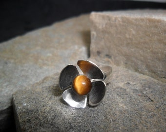 Adorned with a tiger's eye sterling silver flower ring