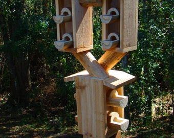 Outdoor bird house feeder looks like 3 wooden birdhouses but is actually a birdfeeder - cool design of 3 different bird house feeders in one