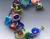 Octopus' Garden Bracelet: handmade glass lampwork beads with sterling silver components