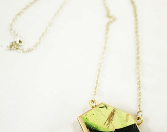 Necklace made with recycled skateboard