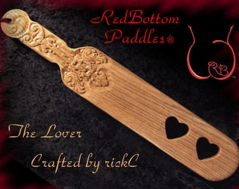 BDSM panking paddle cut through hearts, a great BDSM gift for Mistress or Master