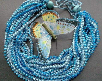 necklace on cotton thread. necklace many rows. necklace blue. Glass Beads. cotton thread.