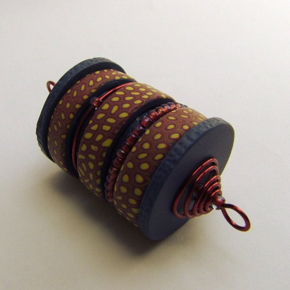 Kinetic cylinder bead pendant, wire wrapped polymer clay art bead, wine indigo yellow