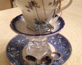 Small vintage two tier tea cup and saucer stand