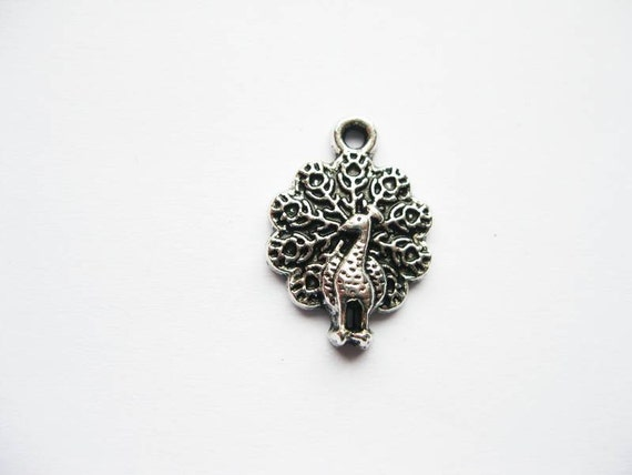8 Peacock Charms in Silver Tone - C055