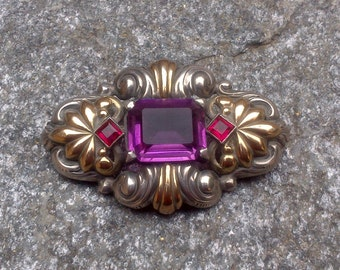 Silver and gold brooch with lilac crystal