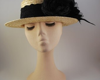 4 TRASNO: Hat very elegant Boater in natural straw with black fabric flowers
