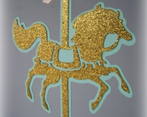 Carousel horse cake topper in gold glitter with pink bow.  Pink, mint green, aqua, robin egg blue, purple. Any color!