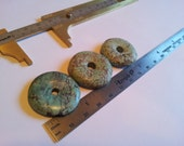 Three 25mm-30mm large turquoise donut pendants about 1 inch each.