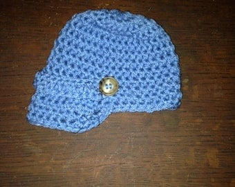 Baby Newsie Hat with Buttoned Flap Detail.