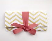 Bridesmaid Clutches in metallic gold chevron with white and dusty rose pink // Custom bow colors available.
