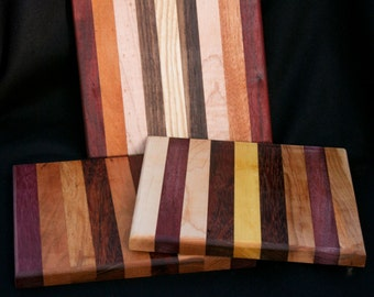 """cutting board/chopping block made of many different woods. 8 x 8.5"""".  Other sizes available.  Random selection by maker"""