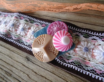 Upcycled vintage trims leather and buttons wrap cuff bracelet cluster pink whimsy boho gypsy wanderlust