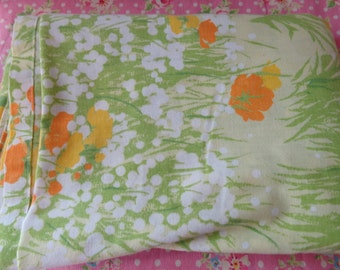 field of flowers. vintage flat sheet. yellow and orange cheery flowers.