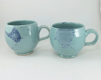 pair of awesome light green and blue mugs