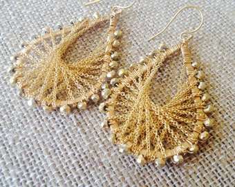 Golden pyrite and woven chain earrings. on SALE. Wholesale price. Originally 130.00. Half off original price.