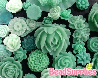 A bag of aqua cabochons - 60 pcs
