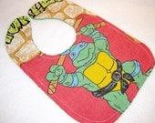 Teenage Mutant Ninja Turtles baby bib themed one size fits all retro upcycled fabric shower gift inspired