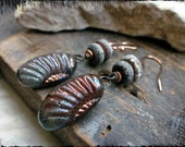Raku ammonite earrings, Handmade lampwork glass Ceramic charms Rustic copper wire - Unearthed