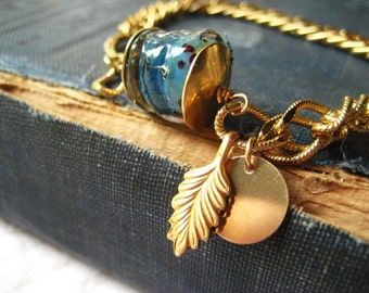 Lampwork bracelet, blue glass bead, vintage gold chain, golden chain, blue boro glass, leaf charm, blue lamp work, womens jewelry