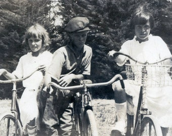 vintage photo 1920 Boy and Girls Ride Bikes in Street He is Leader of the Gang