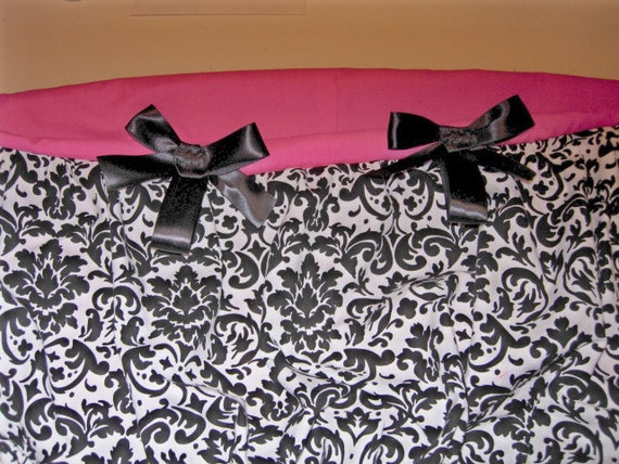 Shopping cart cover in white and black damask with hot pink seat and black bows. Coordinating storage bag