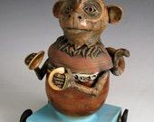 Grinder Monkey Bud Vase on Wheels