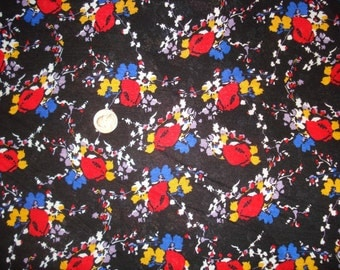 Red and yellow floral print on cotton jersey knit fabric