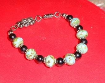 Pretty Seafoam Rondelle and Magnetic bead bracelet