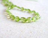 Peridot Gemstone Briolette Faceted Oval Coin Nugget Center Drilled Green 6.5mm 28 beads 1/2 strand