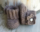 Crochet baby girl boots, in brown with brown  flower and pearl button center. size 0 to 3 mo.