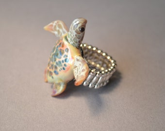 Natural looking Sea Turtle mounted on expandable silver ring band one size fits all