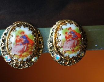 Victorian style vintage 60s gold tone metal  clip on earrings with porcelain centepice , featuring a love couple. Made in West Germany.