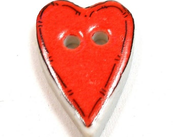 Washable ceramic HEART button, unused.