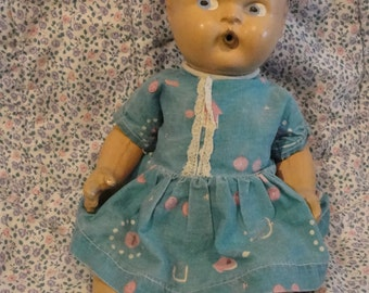 Small 1930s Composition drink and wet baby doll