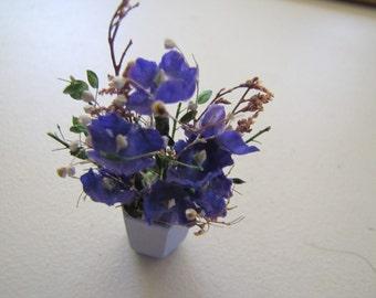 Dollhouse floral arrangement purple flowers in a blue pot