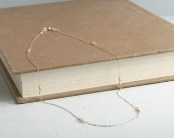 Delicate Gold and Pale Pink Necklace.