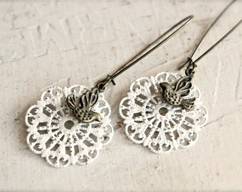 Shabby chic cream filigree dangle earrings with antique brass sparrows. Birds.  Weddings.  Bridesmaids.