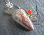 Pendant of Coprolite (petrified dino poo), Carnelian, and Sterling Silver